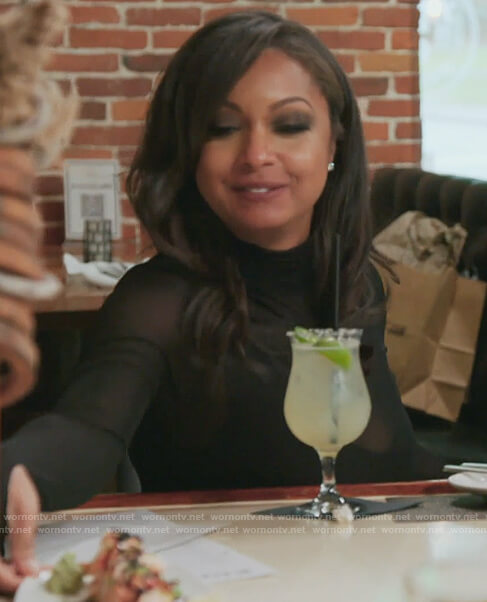 Ebony's mesh turtleneck top on The Real Housewives of New York City