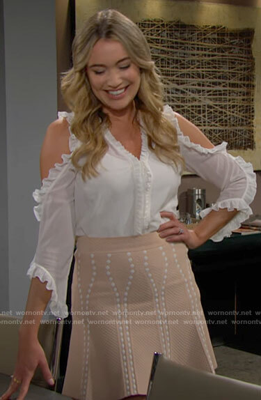 Flo's white ruffle trim top and beige skirt on The Bold and the Beautiful