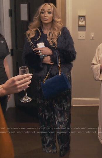 Karen's blue belt print jumpsuit on The Real Housewives of Potomac