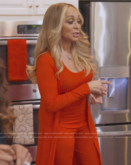 Karen's red ribbed top and cardigan on The Real Housewives of Potomac