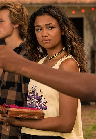 Kiara's cosmic vibrations graphic tank top on Outer Banks