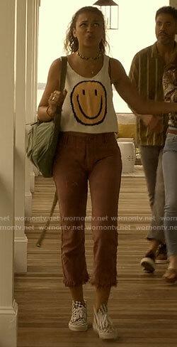 Kiara's smiley emoji tank top on Outer Banks