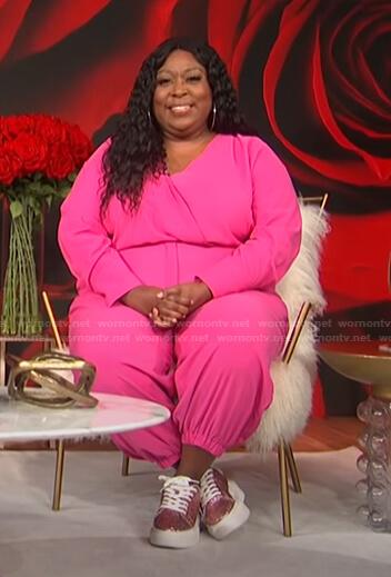 Loni's pink surplice jumpsuit on E! News Daily Pop