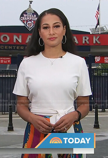 Morgan Radford's white top and mixed print pleated skirt on Today