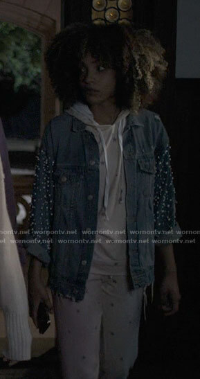 Scarlett's green turtleneck and denim overalls with platform sneakers on American Horror Stories