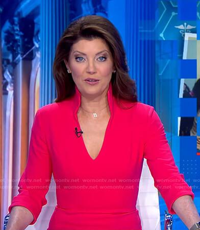 Norah's pink stand collar v-neck dress on CBS Evening News