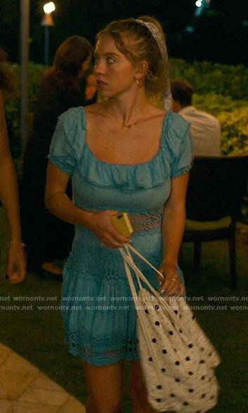 Olivia's blue ruffled dress on The White Lotus