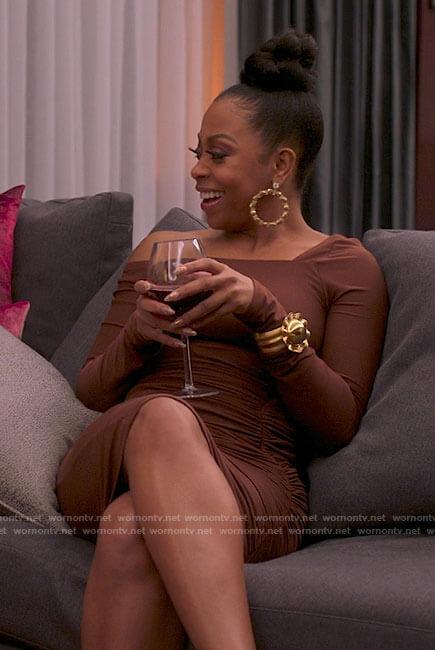 Renee's brown asymmetrical dress on Run the World