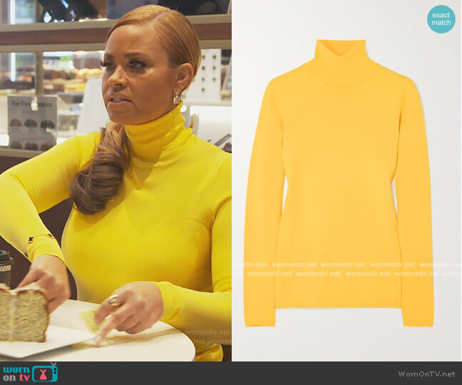 Knitted turtleneck sweater by Stella McCartney worn by Gizelle Bryant  on The Real Housewives of Potomac