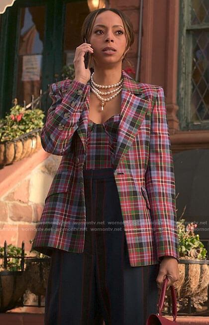Whitney's plaid corset and blazer on Run the World