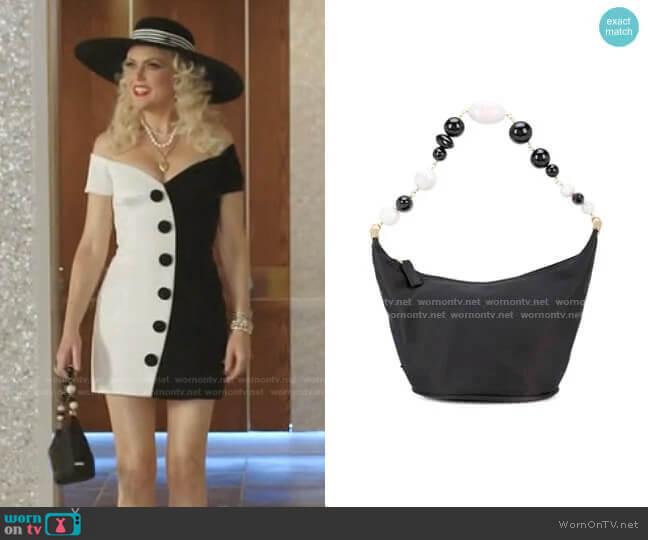 Gia shoulder bag by Cult Gaia worn by Alexis Carrington (Elaine Hendrix) on Dynasty