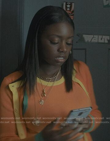 Keisha's orange contrast stripe ribbed cardigan on The Chi