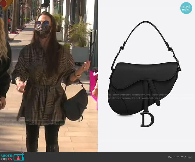 Saddle Bag in Black Ultramatte by Dior worn by Kyle Richards  on The Real Housewives of Beverly Hills