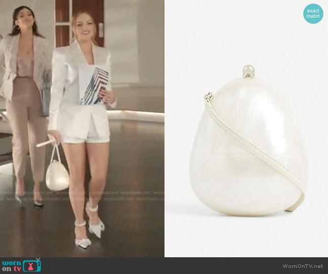 Pearlescent Egg Cross-Body Bag by Simone Rocha worn by Fallon Carrington (Elizabeth Gillies) on Dynasty