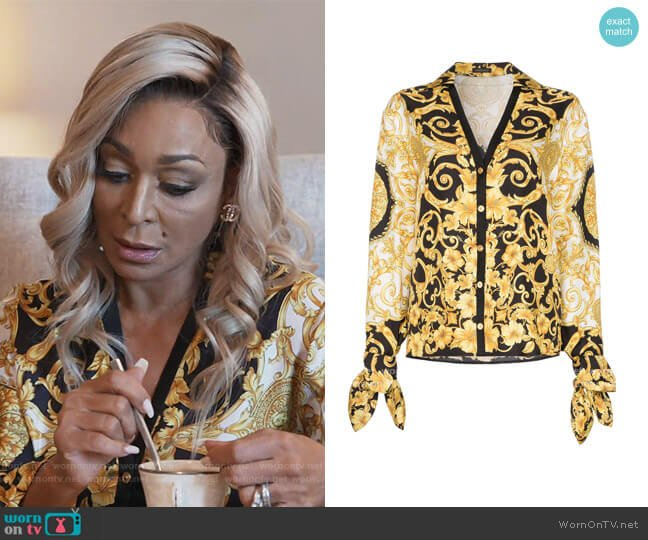 V-neck Baroque-print blouse by Versace worn by Karen Huger  on The Real Housewives of Potomac