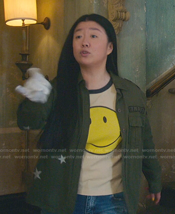 Alice's beige smiley face tee and green star jacket on Good Trouble