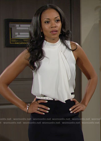 Amanda's white sleeveless ruffle front top on The Young and the Restless