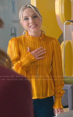 Claire's orange smocked ruffle blouse on Good Trouble