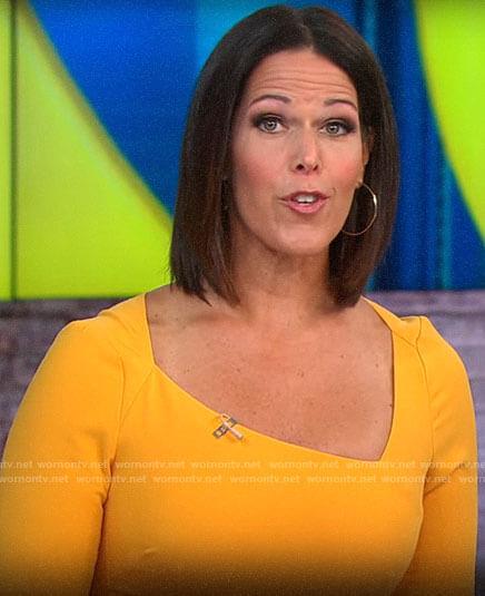 Dana Jacobson's orange dress with asymmetric neckline on CBS This Morning