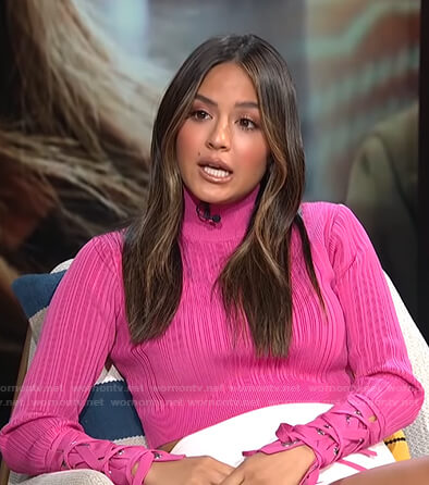 Erin's pink ribbed lace-up sleeve top on E! News Daily Pop