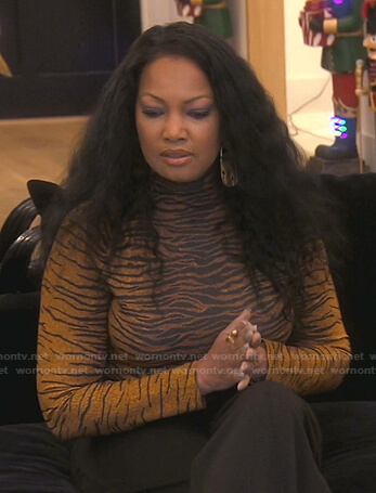 Garcelle's houndstooth ruffle jacket on The Real Housewives of Beverly Hills