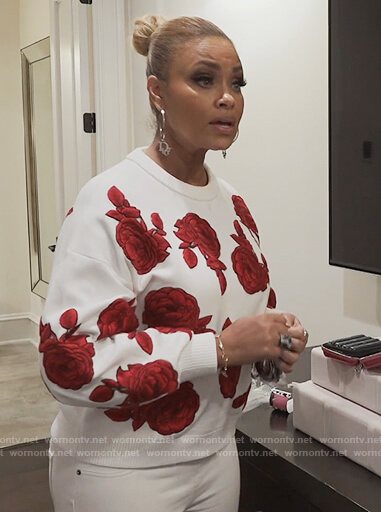 Gizelle's white rose embroidered sweater on The Real Housewives of Potomac