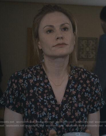Isabelle's black floral v-neck top on Modern Love