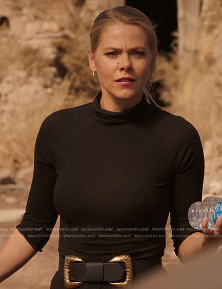 Isobel's black turtleneck top and double buckle belt on Roswell New Mexico