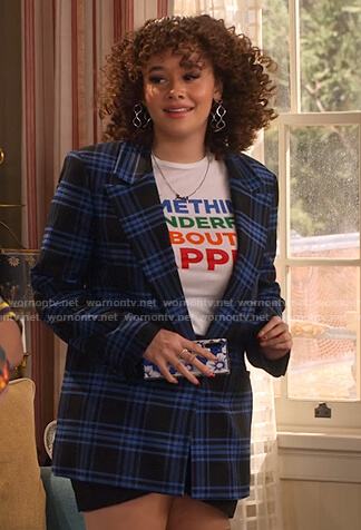 Jade's graphic print tee and black and blue plaid blazer on Family Reunion