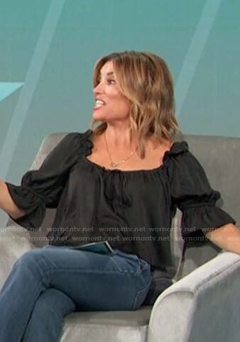 Kit's black ruffle sleeve top on Access Hollywood