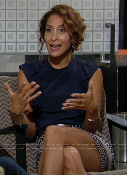 Lily's navy ruffled top and mixed print skirt on The Young and the Restless