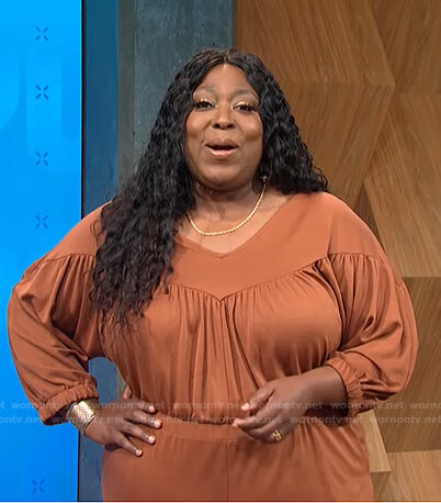 Loni's brown gathered jumpsuit on E! News Daily Pop