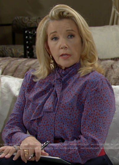 Nikki's blue and red floral tie neck blouse on The Young and the Restless