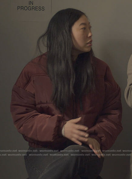 Nora's red puffer jacket with corduroy panels on Awkwafina is Nora From Queens