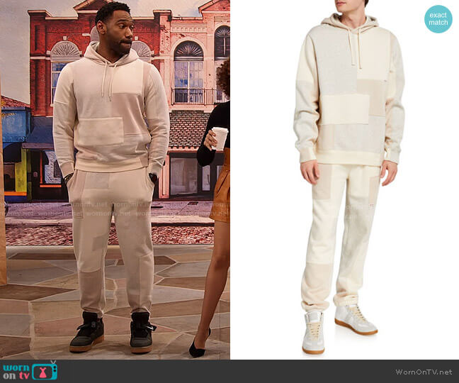 Patchwork Fleece Pullover Hoodie and Sweatpants by Ovadia worn by Moz McKellan (Anthony Alabi) on Family Reunion
