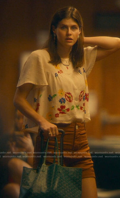 Rachel's tan shorts and floral top on The White Lotus
