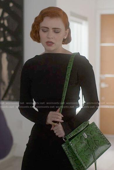 Scarlett's green snake print bag on American Horror Stories
