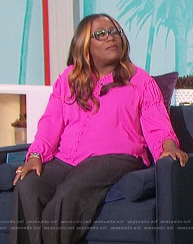 Sheryl's pink ruffle trim blouse on The Talk