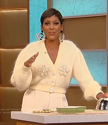 Tamron's yellow cropped floral embellished cardigan on Tamron Hall Show