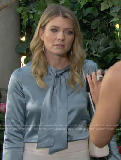 Tara's blue tie neck blouse on The Young and the Restless