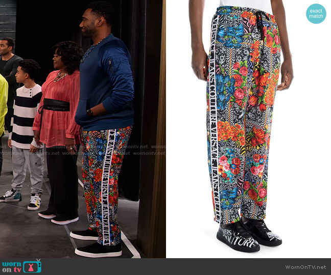 Logo Tape Floral Jogger by Versace worn by Moz McKellan (Anthony Alabi) on Family Reunion