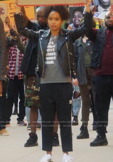 Zoey's black Adidas track pants on Grown-ish