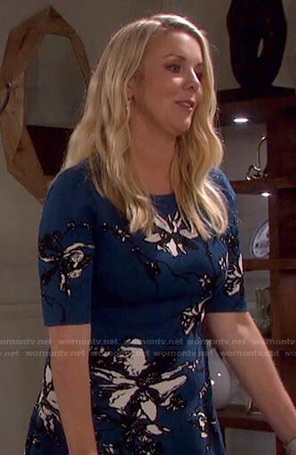 Carrie Brady's blue floral short sleeve dress on Days of our Lives: Beyond Salem