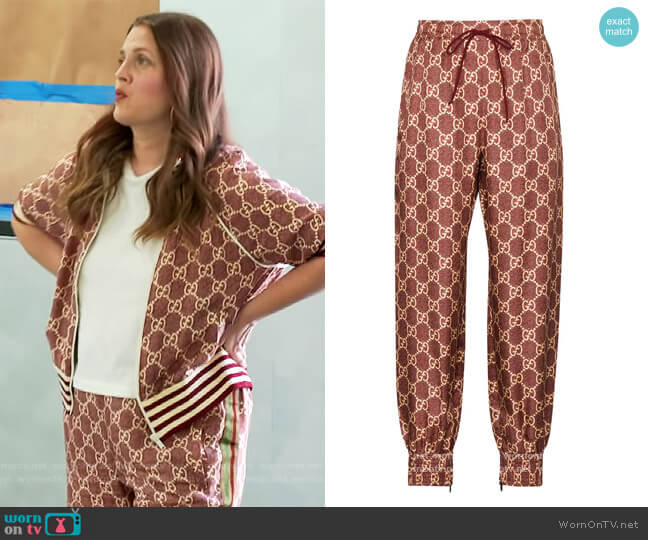 GG Supreme track pants by Gucci worn by Drew Barrymore  on The Drew Barrymore Show