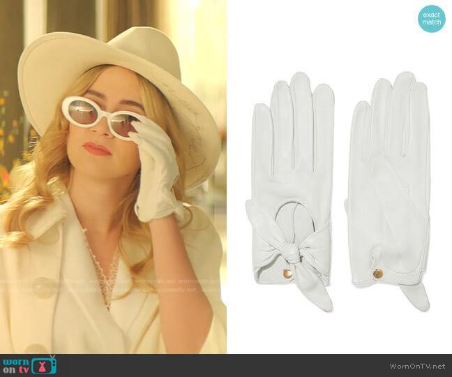 Helena bow-embellished leather gloves by Causse Gantier worn by Amanda Carrington (Eliza Bennett) on Dynasty