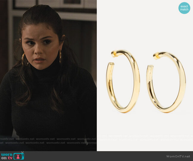 Samira gold-plated hoop earrings by Jennifer Fisher worn by Mabel Mora (Selena Gomez) on Only Murders in the Building
