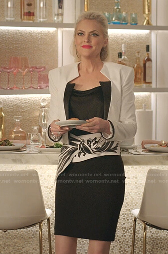 Alexis's white cropped jacket and bow wide belt on Dynasty