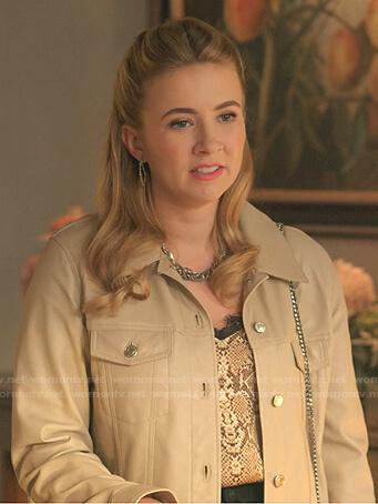 Amanda's snake print top and beige jacket on Dynasty