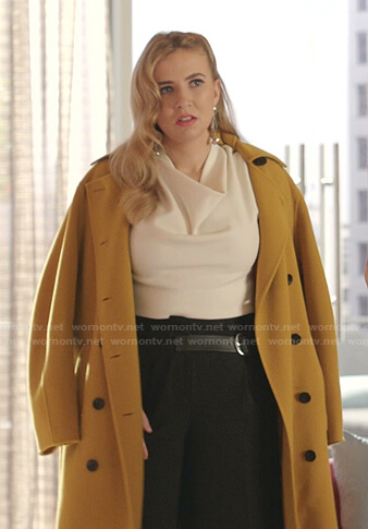 Amanda's white cowl neck top and yellow coat on Dynasty