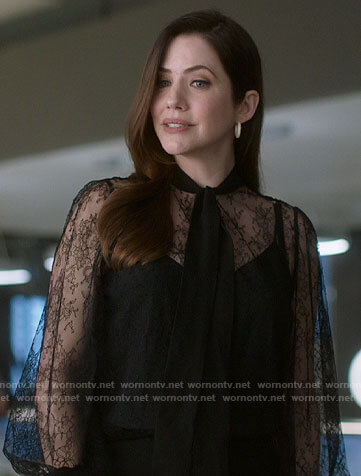 Andrea's black lace tie-neck blouse on Supergirl